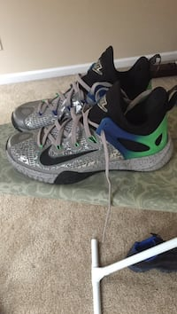 Pair of gray-and-black Nike sneakers Fayetteville, 28306