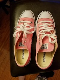 Pink Converse low top tennis shoes