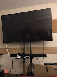 black flat screen TV with black wooden TV stand Cleveland, 44104