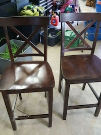 two brown wooden chairs with black leather pads Brant, N3L 1P8