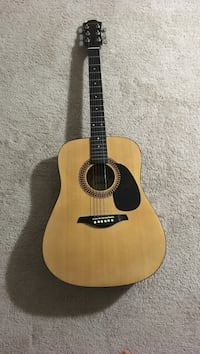 Hohner acoustic guitar with Capo 17 km