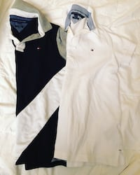 two white and black Tommy Hilfiger polo shirts