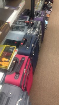 assorted color luggage