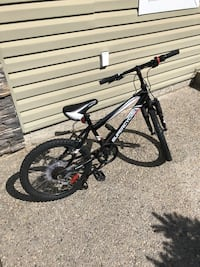 Priced for immediate sale. 3 year old kids bike. New kickstand, fully tuned up this past weekend, near mint condition. Impact suspension technology. Has gear shifts and derailer. Edmonton, T6R 3P2