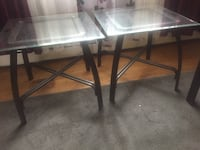 Large glass top table with black metal base. Dartmouth, B3A 3Z9