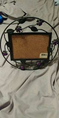 Metal picture frame with purple flowers