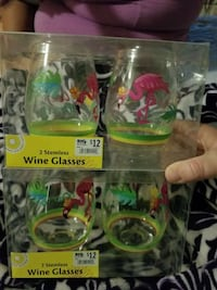 four pink-and-green flamingo etched stemless wineglasses in pack