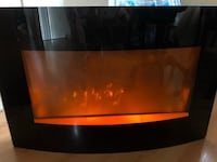 wall black glass fireplace with heat and flame Brampton, L6S 2N6