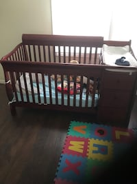 baby's brown wooden crib Bowie, 20715