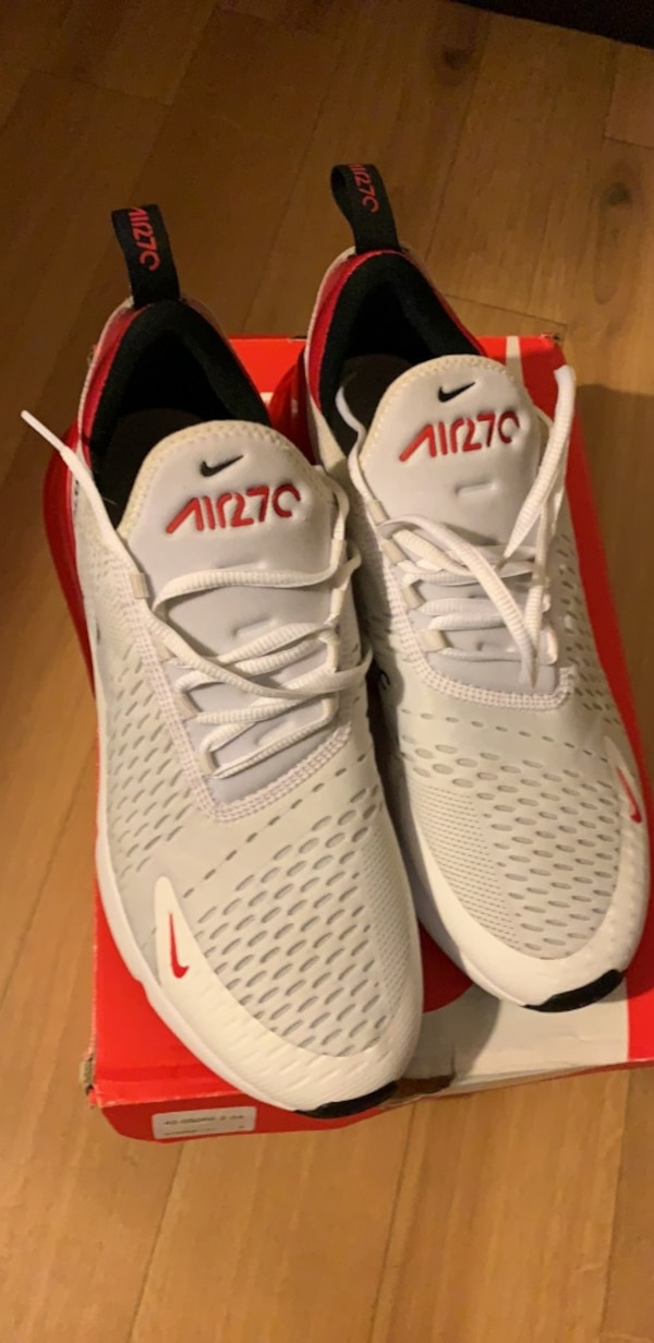 pair of white-and-red Nike running shoes 9b029328-0e0b-4d0e-a07e-f54eb0c12230