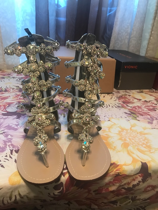 pair of silver-colored open-toe sandals