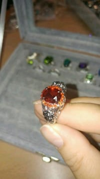 silver and red gemstone ring Montreal, H8T