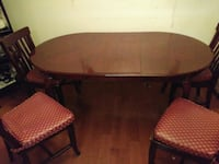 oval brown wooden table with four chairs dining set Silver Spring, 20902