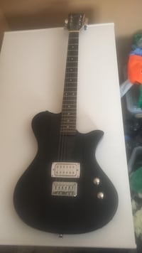 black electric guitar first act Rosamond, 93560