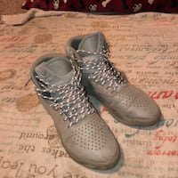 pair of gray Adidas high-top shoes
