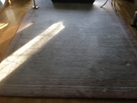 beige and brown area rug