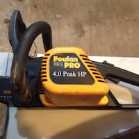 black and yellow Poulan Pro chainsaw 50 km