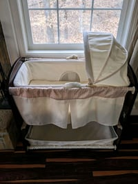 Baby bassinet with storage and changing table