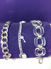 three silver-colored link bracelets