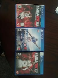 three assorted Sony PS4 game cases