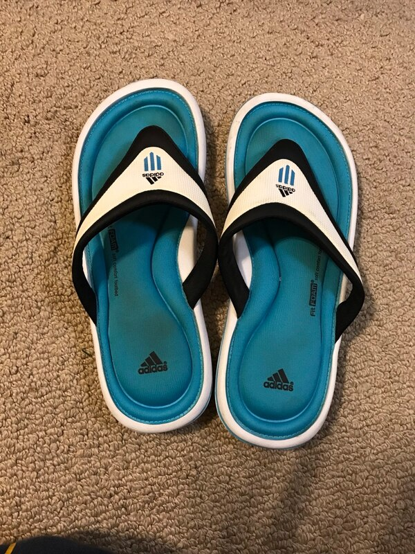 ee87de61d Used pair of blue-and-white Nike slide sandals for sale in Webster ...