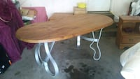 oval brown wooden dining table 1920 mi