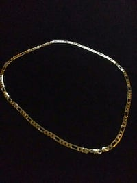 gold-colored figaro necklace