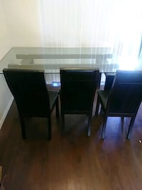 rectangular brown wooden table with four chairs dining set El Paso, 79925