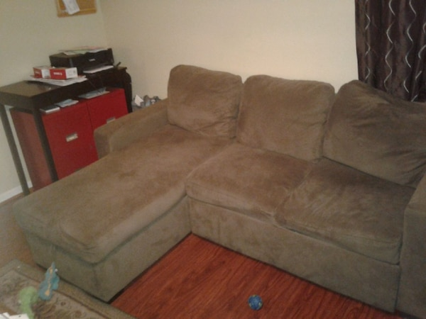 Couch with storage compartment and a pull out bed