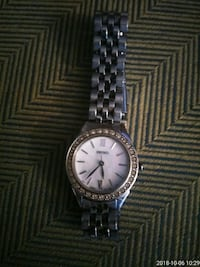 round silver-colored analog watch with link bracelet 709 mi