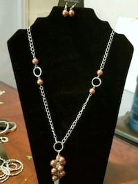 silver-colored chain necklace with pendant Houston, 77099