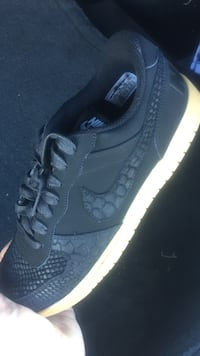 BRAND NEW RARE SIZE 11 snake skin ... originally $140 selling for $70 black Nike low-top sneaker Victorville, 92392