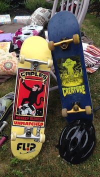 Two yellow and blue skateboards Amesbury, 01913