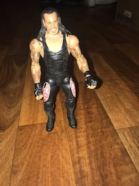 Four wrestling figures 14 wrestling accessories High Point, 27265