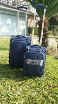 2 Travelpro suitcases