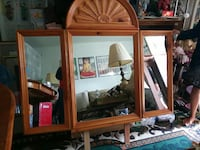 three brown wooden frame wall mirrors
