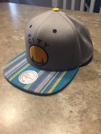 blue and gray New Era 59fifty cap London, N5W 1P7
