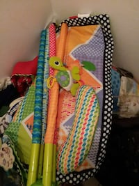 baby's orange, green and purple travel cot Bakersfield, 93305