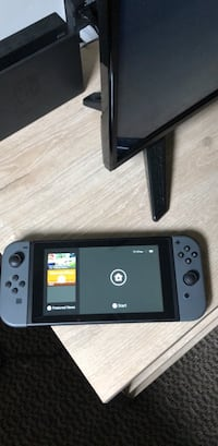 black Nintendo Switch with game case Rockville, 20850