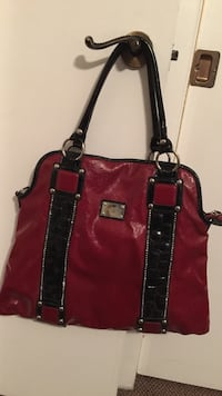 Nicole lee red and black large leather-like bag. Great condition