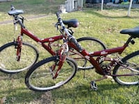 two red Dr. Pepper full-suspension mountain bikes