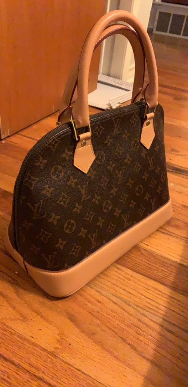 0f3cbf87c03e Used brown Louis Vuitton monogram leather handbag for sale in Dallas - letgo