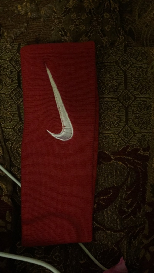 red and white Nike basketball shoe