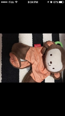 beige, white and brown monkey plush toy