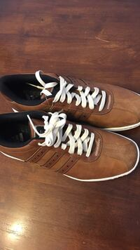 pair of brown-and-white low top sneakers