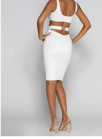 White buckle knee length skirt  Burnaby, V5J 3G1