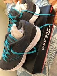 Pair of gray-white-and-teal saucony low-top running shoes with box
