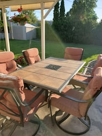Outdoor dining table with 5 chairs