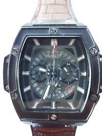 square black chronograph watch with black leather