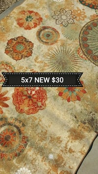brown and orange floral area rug